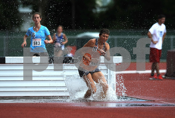 7/15/2017 Mike Orazzi | Staff Maeve Williams and Kirsten Rigney during the 2000 meter steeplechase during the Nutmeg Games held in Willow Brook Park in New Britain Saturday.