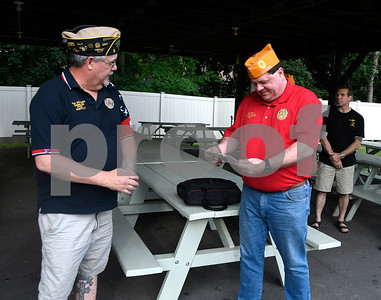 7/6/2017 Mike Orazzi   Staff American Legion Post 2 Commander Rick Schreiner presents Jeff Frain, Sons of The American Legion National Commander, with a license plate during his visit to Bristol Thursday evening.
