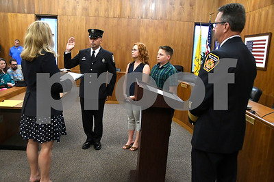 7/6/2017 Mike Orazzi   Staff Bristol Fire Department's  Jason Dufour during his promotion to fire lieutenant at Bristol City Hall Thursday.