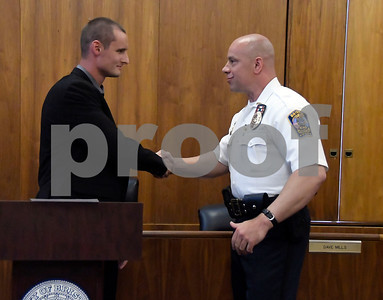 7/6/2017 Mike Orazzi | Staff Future Bristol police officer John D. Clary shakes hands with police chief Brian Gould after taking the oath to become  a Bristol police officer during a ceremony at city hall Thursday afternoon