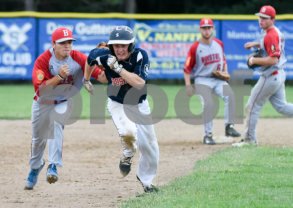 070617 Wesley Bunnell | Staff Southington vs Bristol in American Legion Baseball on Thursday evening at Southington High School. Alec DiLoreto (14) tags Daniel Topper (6) on a rundown after Topper was caught off second base.
