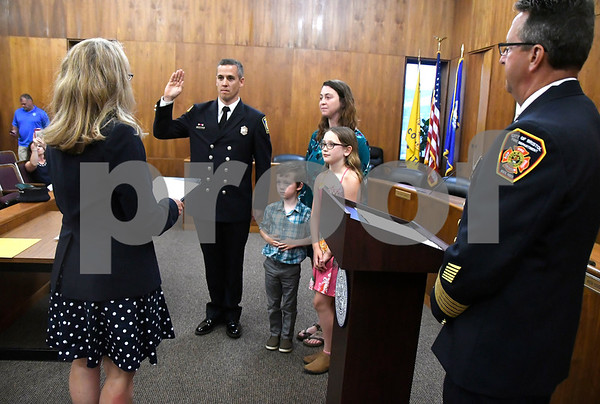 7/6/2017 Mike Orazzi | Staff Bristol Fire Department's Todd Correll takes the oath of office during his promotion to fire captain at Bristol City Hall Thursday.