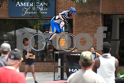 7/8/2017 Mike Orazzi | Staff Joe Janicki performs stunts on his bike during the 4th Annual Bike Safety Day in downtown New Britain Saturday.