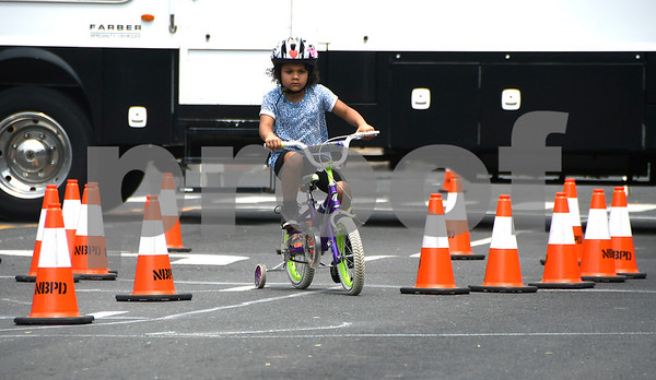 7/8/2017 Mike Orazzi | Staff Zoey Garcia,5, rides through the obstacle course during the 4th Annual Bike Safety Day in downtown New Britain Saturday.