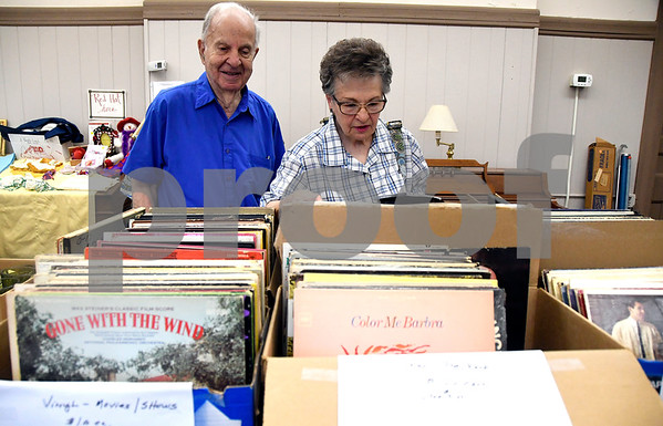 7/8/2017 Mike Orazzi | Staff Dan and Dorene Nocera look through vinyl records for sale during the Bristol Historical Society Tag Sale Saturday morning.