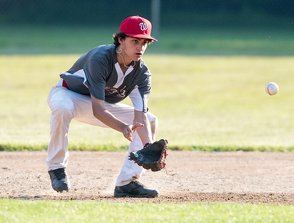 07/02/18 Wesley Bunnell | Staff Edgewood vs Southington S/W in a district 5 senior league baseball game on Monday evening in Bristol. Cam Destern (16) fields and throws to second to force the runner.