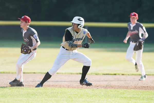 07/02/18 Wesley Bunnell | Staff Edgewood vs Southington S/W in a district 5 senior league baseball game on Monday evening in Bristol. Gabe Bartolome (8) is caught in a run down between first and second and would eventually be chased down for the out.