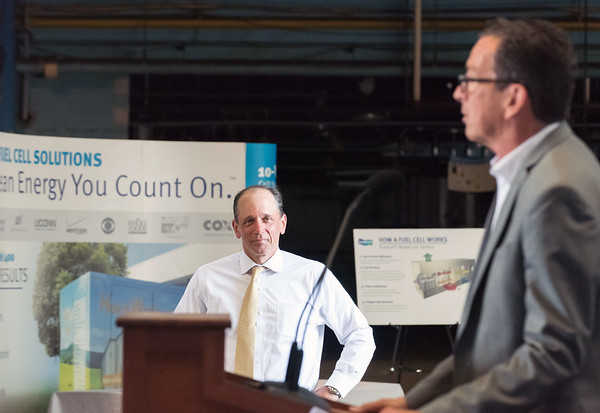 07/02/18 Wesley Bunnell | Staff Governor Dannel Malloy speaks on Monday at the future site of a high speed data center on 100 Curtis St as developer Mark Wick from the EIP looks on. Governor Dannel Malloy, Mayor Erin Stewart, developers from EIP, LLC as well as other political and community members held the conference on the former Stanley Black & Decker site, to celebrate the upcoming fuel cell powered high speed data center complex which is to begin construction next year. The project is expected to create more than 3,000 jobs over the next 10 years.