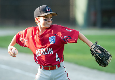 07/10/18  Wesley Bunnell | Staff  Brandon Garrity (4) warms up the right fielder on the bottom of the fifth inning. Berlin 12U baseball was eliminated by Yalesville 2-0 on Tuesday evening at Bill Petit Complex.
