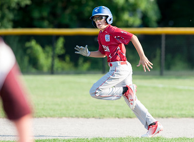 07/10/18  Wesley Bunnell | Staff  Evan Gentile (1) glances towards third on a ground ball as he advances to second base. Berlin 12U baseball was eliminated by Yalesville 2-0 on Tuesday evening at Bill Petit Complex.