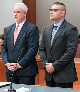 07/10/18  Wesley Bunnell | Staff  Former New Britain and current Rocky Hill Police Officer Jacob Boucher, R, stands with his attorney at New Britain Superior Court on Tuesday morning. Boucher was arrested last week regarding a June 30 incident in New Britain.