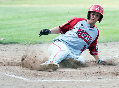 07/16/18  Wesley Bunnell | Staff  Bristol defeated Plainville in legion baseball on Monday night at Trumbull Park in Plainville.  Alec Diloreto (14) slides safely into home.
