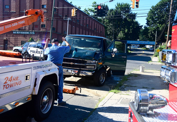 7/19/2018 Mike Orazzi | Staff The scene of a two-vehicle crash at the intersection of Riverside and Mellon Street Thursday afternoon. Both vehicles were towed from the scene and no injuries were reported.