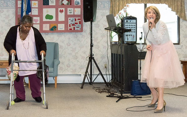 05/15/18 Wesley Bunnell | Staff Singer Kate Stone entertained the residents of Autumn Lake Healthcare in New Britain during Happy Hour on Wednesday May 15th. Resident Harriet Taylor, L, dances in front of fellow residents as Stone performs.