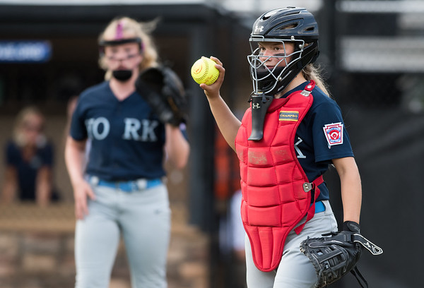 07/23/18 Wesley Bunnell | Staff York, ME defeated Peabody, MA 1-0 in Little League Eastern Region Softball on Monday afternoon. York catcher Chloe Bourque (10) looks the Peabody runner back to third.