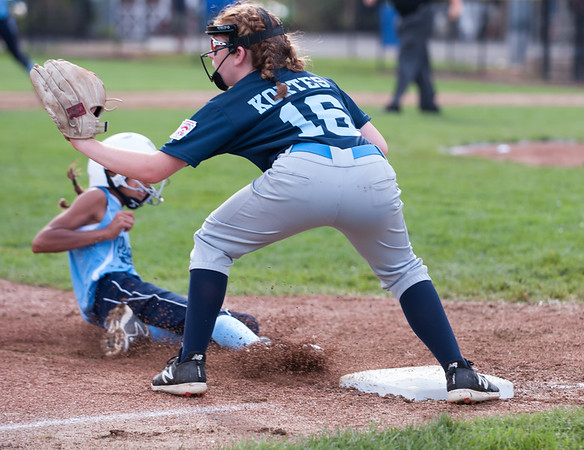 07/23/18 Wesley Bunnell | Staff York, ME defeated Peabody, MA 1-0 in Little League Eastern Region Softball on Monday afternoon. York third baseman Meghan Daly (18) takes the throw from the left fielder but is too late to get the Peabody runner Hailey Roach (15).