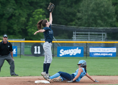 07/23/18  Wesley Bunnell | Staff  York, ME defeated Peabody, MA 1-0 in Little League Eastern Region Softball on Monday afternoon. York's Ava Brent (1) leaps but the throw from home sails over her head to allow Peabody's Avery Grieco (0) to slide safely into second base.