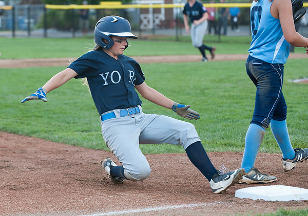 07/23/18 Wesley Bunnell | Staff York, ME defeated Peabody, MA 1-0 in Little League Eastern Region Softball on Monday afternoon. York's Chloe Bourque (10) slides safely into third base.