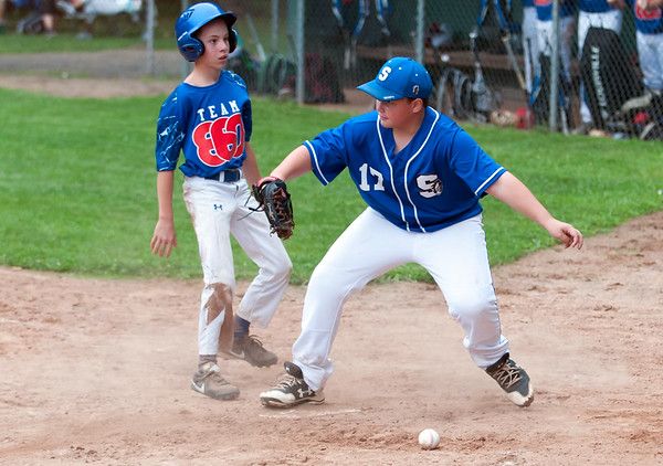 07/30/18 Wesley Bunnell | Staff The Southington Travel Knights 12U baseball was defeated 10-0 by the Catalyst Bombers at A.W. Stanley Park on Monday evening in Nutmeg Games action. Pitcher Evan Wilcox (17) covering home plate.