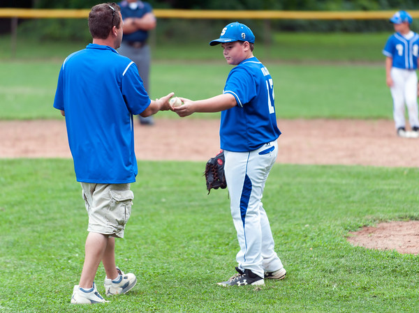 07/30/18 Wesley Bunnell | Staff The Southington Travel Knights 12U baseball was defeated 10-0 by the Catalyst Bombers at A.W. Stanley Park on Monday evening in Nutmeg Games action. Pitcher Evan Wilcox (17) hands the ball to the coach after being removed from the game.