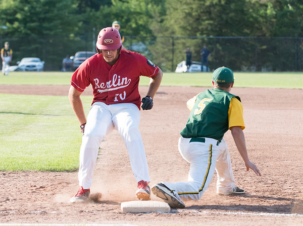 07/12/18 Wesley Bunnell | Staff Berlin Legion baseball vs RCP at Sage Park on Thursday evening. Paul D'Amore (10) hustles back to first base but was doubled off on a close play after the RCP fielder handled the line drive and threw to first.