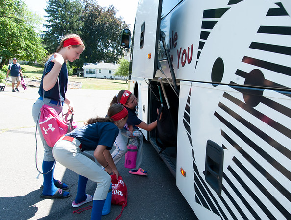 07/12/18 Wesley Bunnell | Staff Jessica Petit, R, helps her teammates from the Berlin softball 9-11 year old District 5 Champions load equipment onto their charter bus as they prepared to drive to Trumbull to take on Wilton on Thursday afternoon.