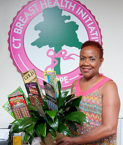 07/12/18  Wesley Bunnell | Staff  Linda Carroll stands with a gift basket of lottery tickets as a thank you for being the top fund raiser for the 2018 Connecticut Breast Health Initiative's Race In the Park which took place on May 12th.