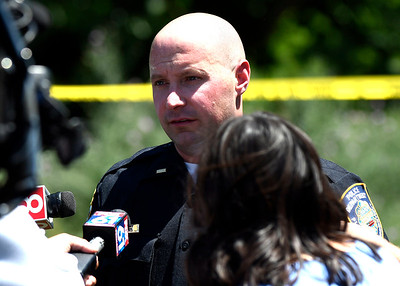 7/12/2018 Mike Orazzi | Staff Lt. Nick Mullins of the Plainville Police Department during a press conference at the scene of a fatal plane crash in a wooded area near the Robertson Airport in Plainville Thursday morning around 10:30. Members of the National Transportation Safety Board, Plainville Police and fire departments along with the medical examiners office responded to the scene.