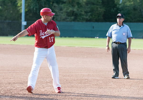 07/12/18 Wesley Bunnell | Staff Berlin Legion baseball vs RCP at Sage Park on Thursday evening. A Berlin coach argues the call at first which doubled Paul D'Amore (10) off after the RCP fielder caught a line drive.