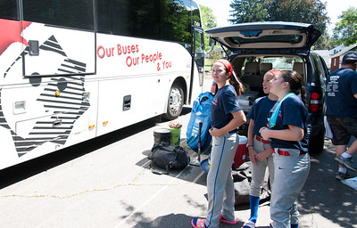 07/12/18  Wesley Bunnell | Staff  Jessica Petit, L, Amelia Andruskiewicz, R, and teammates from the Berlin softball 9-11 year old District 5 Champions look over their charter bus as they prepared to drive to Trumbull to take on Wilton.