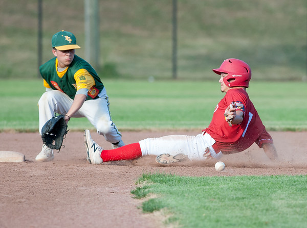 07/12/18 Wesley Bunnell | Staff Berlin Legion baseball vs RCP at Sage Park on Thursday evening. Michael Giove (1) slides safely into second base.