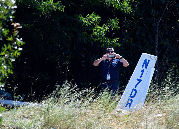 7/12/2018 Mike Orazzi | Staff Investigators on scene of a fatal plane crash in a wooded area near the Robertson Airport in Plainville Thursday morning around 10:30. Members of the National Transportation Safety Board, Plainville Police and fire departments along with the medical examiners office responded to the scene.