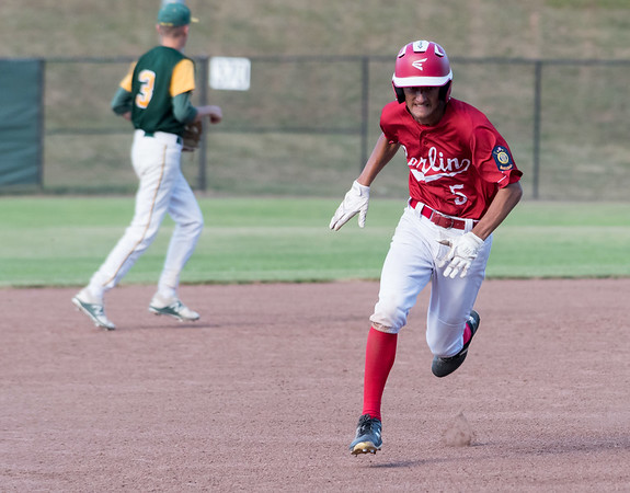 07/12/18 Wesley Bunnell | Staff Berlin Legion baseball vs RCP at Sage Park on Thursday evening. Gianni Fanelli (5) hustles from 2nd and rounds third base to score and give Berlin a 1-0 lead.