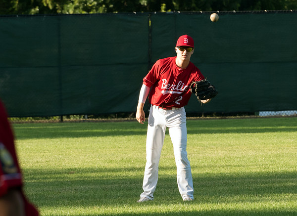 07/12/18 Wesley Bunnell | Staff Berlin Legion baseball vs RCP at Sage Park on Thursday evening. Left fielder Connor Giudice (22) is throws with Mark Addamo (20).