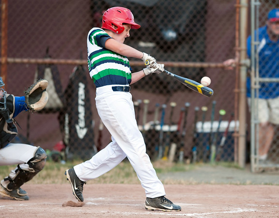 07/13/18 Wesley Bunnell | Staff Edgewood Little League was defeated 4-3 by Wallingford on Friday night in Southington. Mason Harris (25) makes contact.