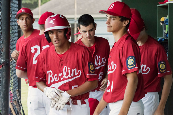 07/12/18 Wesley Bunnell | Staff Berlin Legion baseball vs RCP at Sage Park on Thursday evening. Gianni Fanelli (5) is congratulated by teammates in the dugout including Mark Addamo (20) after scoring from second base to give Berlin a 1-0 lead.