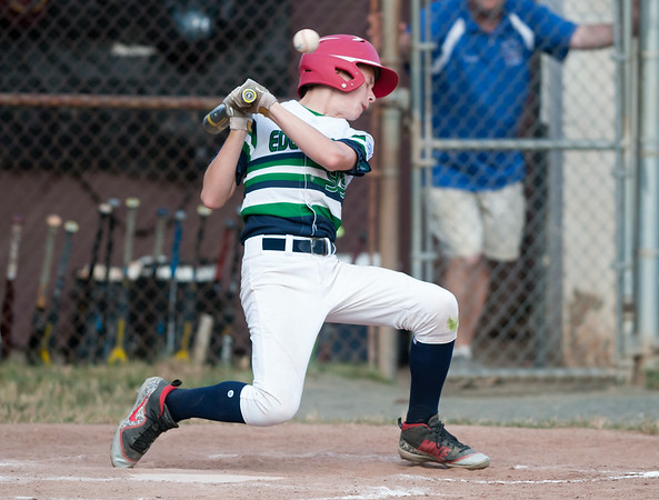 07/13/18 Wesley Bunnell | Staff Edgewood Little League was defeated 4-3 by Wallingford on Friday night in Southington. Braydon Dauphinais (99) ducks out of the way of a close pitch.
