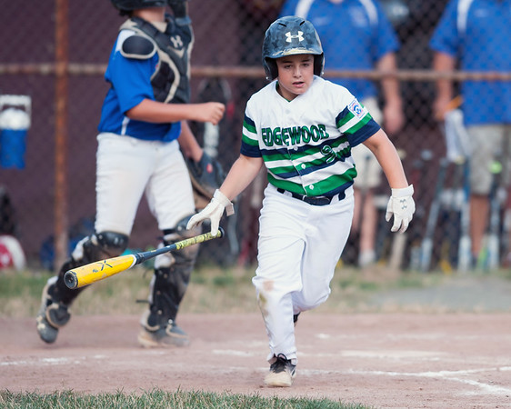 07/13/18 Wesley Bunnell | Staff Edgewood Little League was defeated 4-3 by Wallingford on Friday night in Southington. Ben DAmato (9) drops the bat as he runs down the first base line.