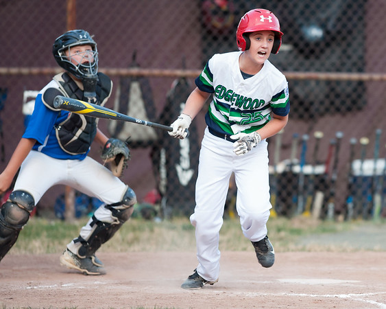 07/13/18 Wesley Bunnell | Staff Edgewood Little League was defeated 4-3 by Wallingford on Friday night in Southington. Mason Harris (25) reacts as he watches his ball go foul down the first base line.