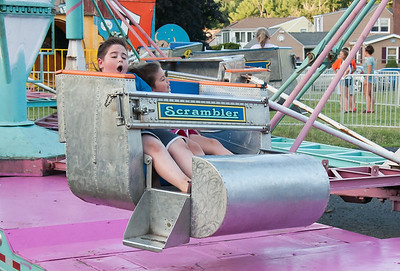 07/12/18  Wesley Bunnell | Staff  Thomas DeNapoli, L age 10, and Katherine DeNapoli, age 7, ride the Scrambler during the first night of the Holy Cross Church's Sixty-'Fourth Bazaar and Carnival on Thursday night.
