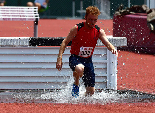 7/14/2018 Mike Orazzi | Staff Jacob Oneal in the 2000 Meter Steeplechase during the Nutmeg State Games held at Veterans Memorial Stadium in New Britain Saturday.