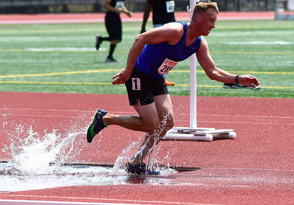 7/14/2018 Mike Orazzi | Staff Scott Maxwell in the 2000 Meter Steeplechase during the Nutmeg State Games held at Veterans Memorial Stadium in New Britain Saturday.