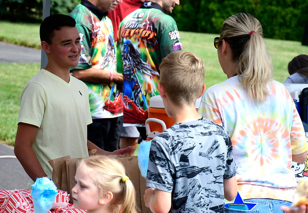 7/14/2018 Mike Orazzi | Staff Nico Fasold while serving homemade lemonade during Nicos Lemonade Stand to raise money for the Make-A-Wish Foundation on Northwest Drive in Plainville Saturday morning.