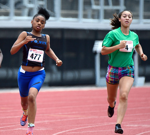 7/14/2018 Mike Orazzi | Staff Valiese Thomas and Amanda Alegria during the 400 meter at the Nutmeg State Games held at Veterans Memorial Stadium in New Britain Saturday.