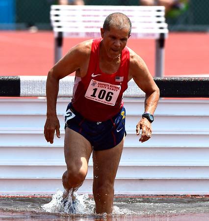 7/14/2018 Mike Orazzi | Staff Joe Cordero in the 2000 Meter Steeplechase during the Nutmeg State Games held at Veterans Memorial Stadium in New Britain Saturday.
