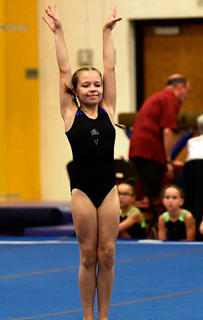 7/14/2018 Mike Orazzi | Staff Olivia Tenan performs in the floor exercise at the Nutmeg Games Gymnastics competition held at New Britain High School Saturday.