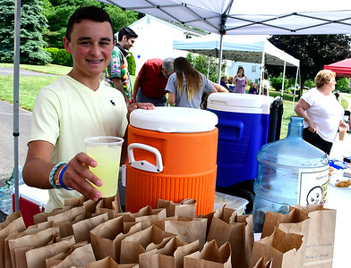 7/14/2018 Mike Orazzi   Staff Nico Fasold while serving homemade lemonade during Nico's Lemonade Stand to raise money for the  Make-A-Wish Foundation on Northwest Drive in Plainville Saturday morning.