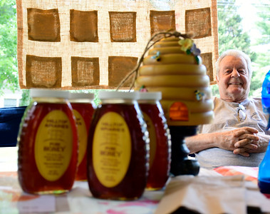 7/14/2018 Mike Orazzi   Staff Dennis Fagan while selling honey during the Berlin Farmers Market held at Hungerford Park Saturday morning.