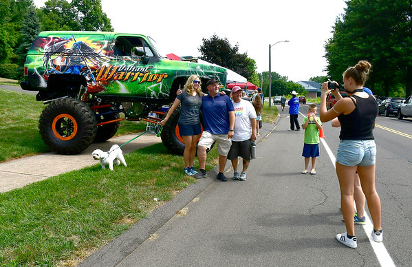 7/14/2018 Mike Orazzi | Staff Monster trucks on display during the Nicos Lemonade Stand fundraiser for the Make-A-Wish Foundation on Northwest Drive in Plainville Saturday morning.