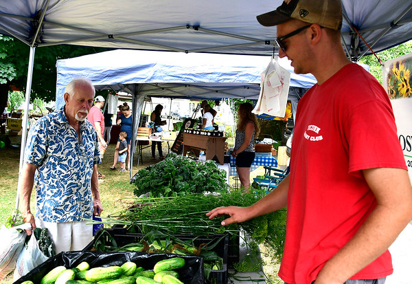7/14/2018 Mike Orazzi | Staff Rodney Beaulieu talks with Bostrom Farm Stand's Brian Bostrom during the Berlin Farmers Market held at Hungerford Park Saturday morning.